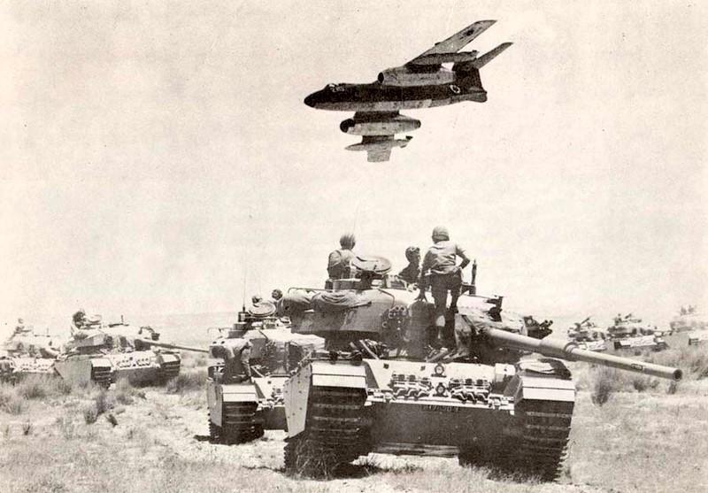 Sud Aviation Vautour II over Israeli armoured formation.