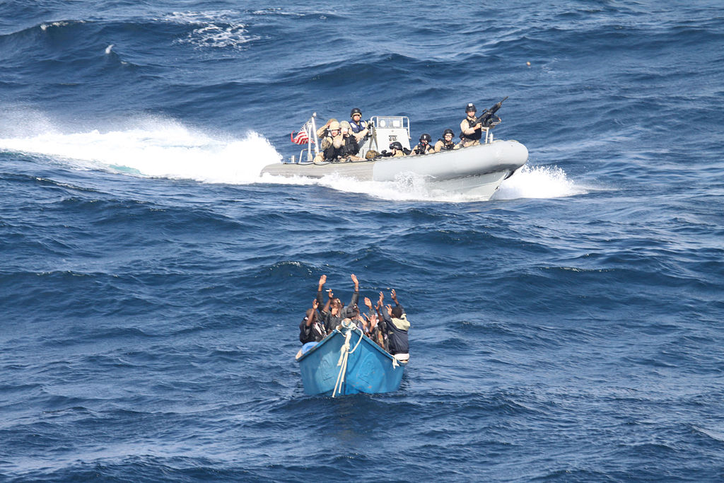 Team from the guided-missile destroyer USS Pinckney approaches asuspected pirate vessel. Official US Navy photo.